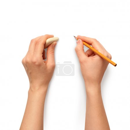 Human hands with pencil and erase rubber writting ...
