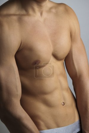 Photo for Part of the beautiful male body inflated - Royalty Free Image