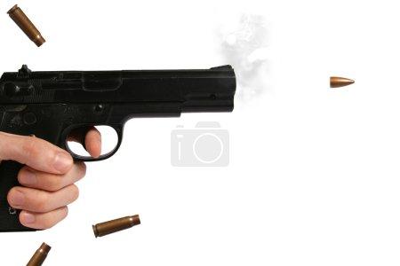 Photo pour Pistolet et balle volante isolés sur fond blanc - image libre de droit