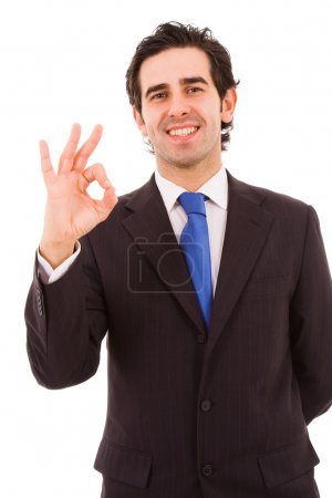 Happy young business man gestures ok sign, isolated on white