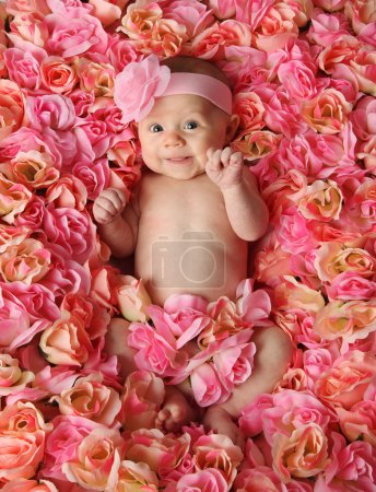 Baby in a bed of roses