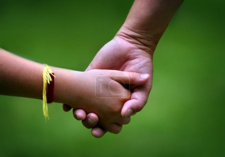 Photo for Mom and her young daughter holding hands - Royalty Free Image