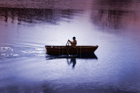 A man in his rowing boat
