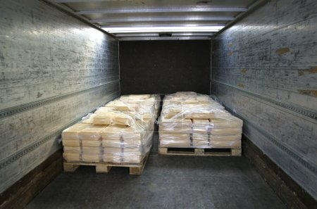 Photo for Manufactured cheese on pallets in back of refridgerated truck - Royalty Free Image