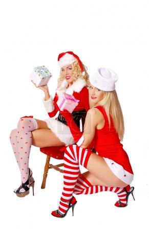 Two christmas girls offering gifts