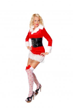 Photo for Girl in a Christmas costume slightly crouched, hands on hips. - Royalty Free Image