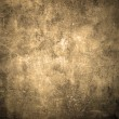 Old and grunge wall texture in sepia color. Can be...
