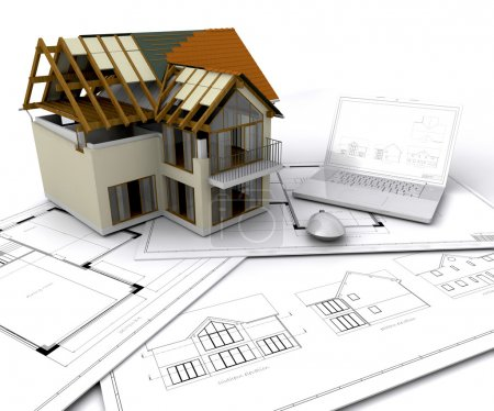 Photo for House under construction on plans with laptop - Royalty Free Image