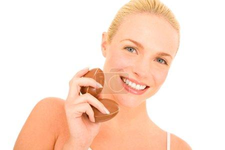 Woman holding chocolate eggs