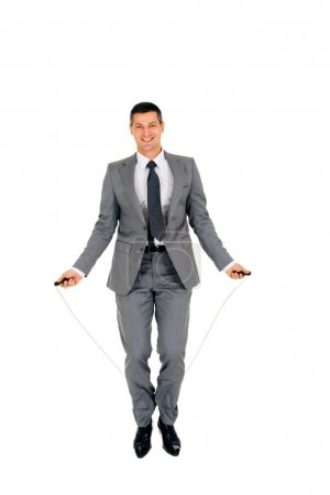 Businessman jumping rope