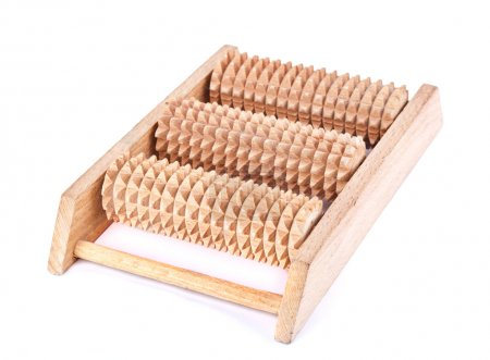 Photo pour Outil de massage pour la zone réflexe des pieds sur fond blanc - image libre de droit