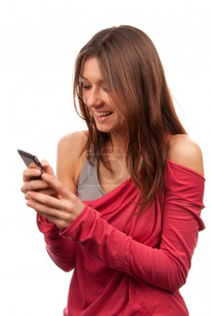 Woman reading, typing and sending SMS on mobile cellphone
