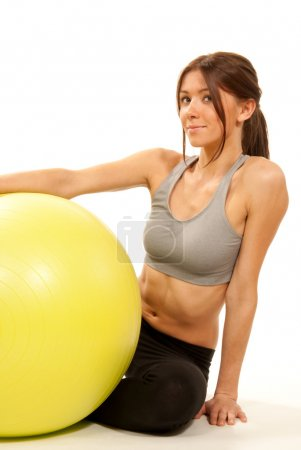 Female fitness instructor with pilates ball