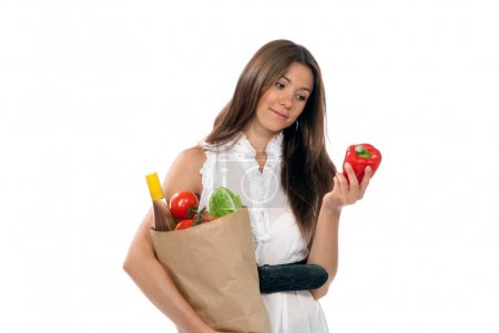 Young woman hold shopping paper bag full of vegetarian groceries
