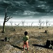 Kids contemplating a view of a dead forest as far ...