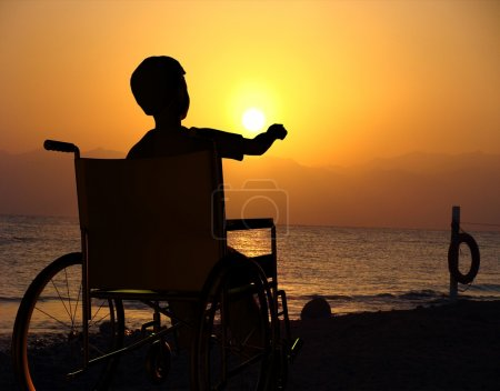 Photo for Silhouette of man on a wheelchair - Royalty Free Image
