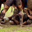 Man in the mud at rugby...