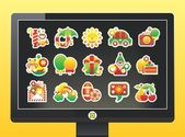 Monitor with holiday icons on a black background