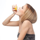 Profile of a woman drinking lemon juice