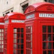 Row of phone booths in London, England. Street vie...