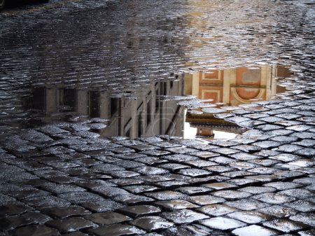 Reflection in puddles after rain