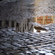 Cobblestone - old street in Rome (Italy). A view j...