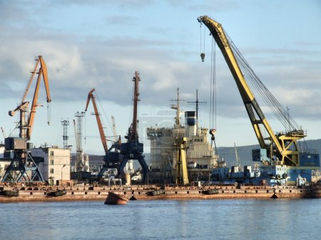 Large and busy sea port in Murmansk, Russia....