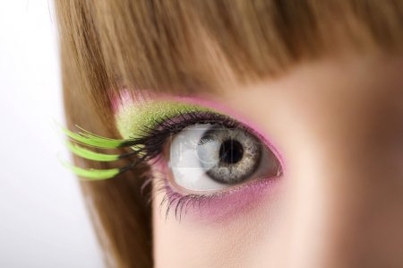 Photo for Eye lloking in camera with colored make up and long eyelashes - Royalty Free Image
