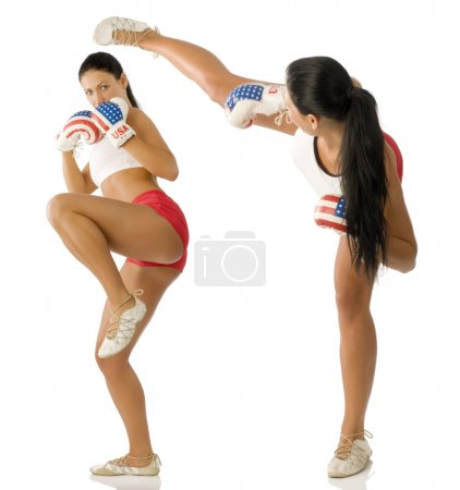 Photo for Twins beautiful brunette with boxing gloves fighting and kicking - Royalty Free Image
