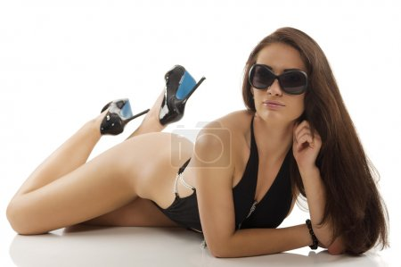 Brunette in black swimsuit laying