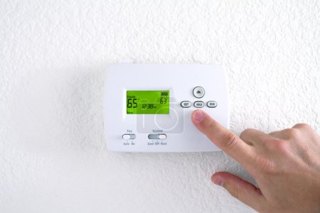 Digital thermostat on the white wall...