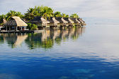 Amazing tropical resort with huts over water