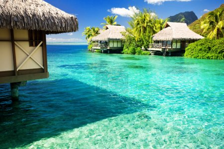 Over water bungalows with steps into amazing lagoon