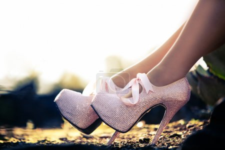 Close up of a pink high heels with diamons