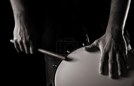 Playing repinique (rep; repique; two-headed Brazilian drum); where one hand