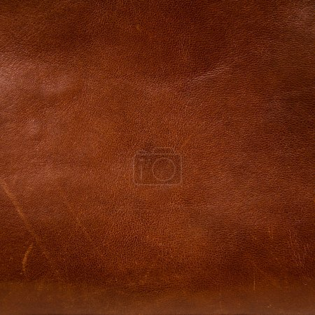 Old, worn and scratched brown leather background