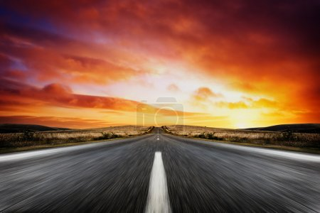 Photo for Road leading into a beautiful sunset - Royalty Free Image