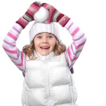 Photo for Cute little girl in warm clothes on white background with snowball playing - Royalty Free Image