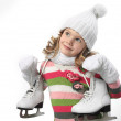 Cute little girl in warm hat and gloves with figur...