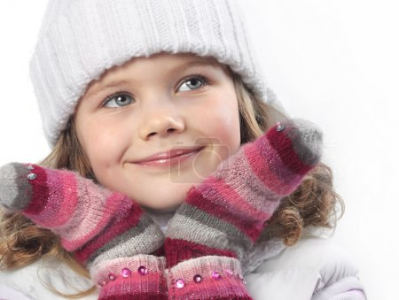 Photo for Cute little girl in warm clothes on white background - Royalty Free Image