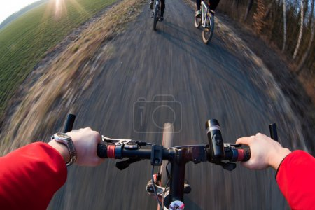 Riding a mountain bicycle on a country road (motion blurred imag