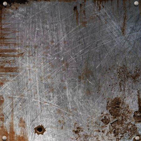 plaque de métal rouillé