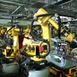 Welding robots in a car manufactory...