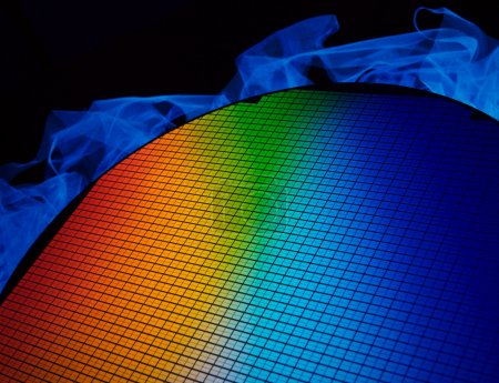 Photo for Detail of a silicon chip wafer reflecting different colors - Royalty Free Image