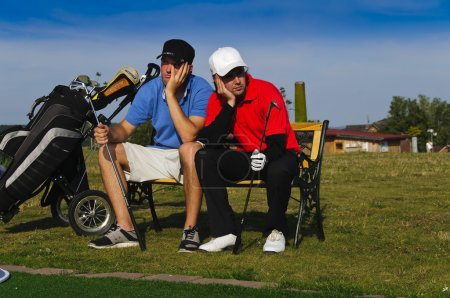 Two young golfers are frustrated