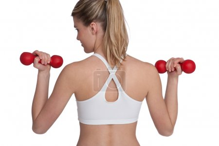 Fitness - Young sportive woman exercise with weights