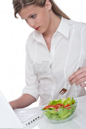 Healthy lifestyle series - Woman with laptop and bowl of salad