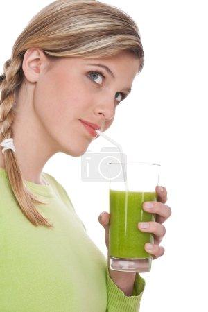 Healthy lifestyle series - Woman drinking kiwi juice