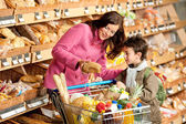 Grocery store shopping - Woman with little boy
