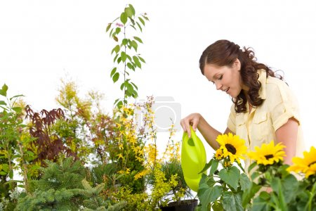 Gardening - Woman pouring plants with watering can